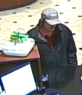 A suspect is shown at the counter at First Cloverleaf Bank in Edwardsville on Friday in a robbery.
