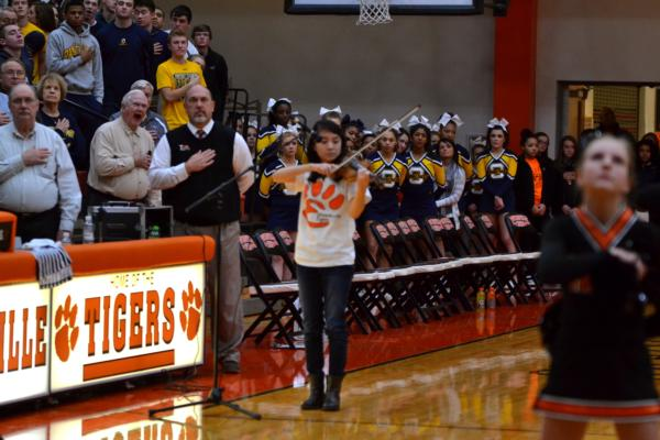 Violinist Faith Tan performs the National Anthem at Friday's Edwardsville home basketball game against O'Fallon.