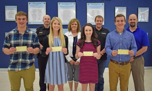 Pictured from left to right: (front—Senior students) Stephen Rulo, Anne Snyders, Maddie Hansen, and Quinten Dial. (back) Officer Rich Portwood, Illini Middle School representative Sue Long, Jersey County Code Officer Derick Russel, and CNB Bank & Trust Asst. VP Matt Eschbach.